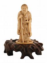 Meiji period ivory sage figure holding a staff and