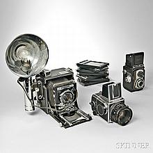 Hasselblad 500C/M and Two Other Cameras, Sweden, c. 1980, black and chrome body with pop-up focusing hood, Zeiss 80mm f/2.8 Planar lens