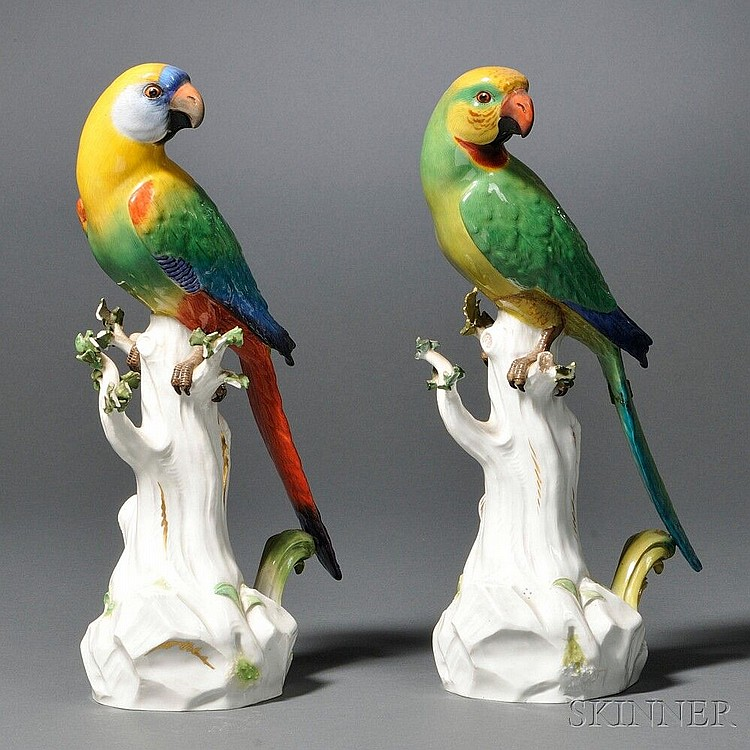 Pair of Paris Porcelain Parrot Figures, (staple repair to one tail, small losses to foliage), ht. 12 5/8 in.