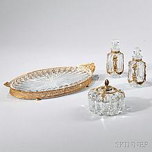 Assembled Glass and Dore Bronze Four-piece Dresser Set, 20th century, each glass with lobed body, a Heisey glass oval tray set in a pie