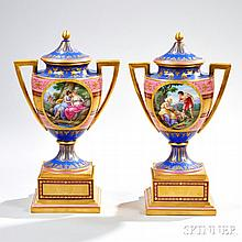 Pair of Royal Vienna Porcelain Vases, 19th century, each with knob-top cover and stand, polychrome ground of predominantly blue, vasifo