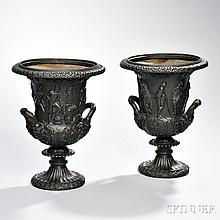 Pair of Patinated Bronze Medici-style Vases, Continental, 19th century, each with wide gadrooned mouth edged underneath in fruiting gra