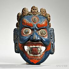 Rajbansi Dance Mask, Tibet/Bhutan, 19th century, depicting the blue-faced Mahakala with bulging eyes, fierce grimace and a crown of fiv