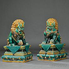 Pair of Large Ceramic Buddhist Lions, China, late 19th/early 20th century, sancai glaze, traditionally depicted, the male with a globe