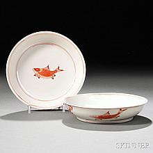 Pair of Porcelain Dishes, China, for export, the interior of the shallow dishes decorated with a fish motif in iron red glaze inside tw