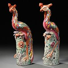 Pair of Porcelain Phoenixes, China, 20th century, representing male and female fenghuang, with flowers and auspicious mushrooms, ht. 19