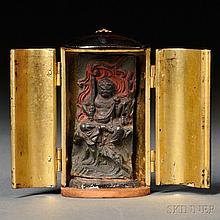 Lacquer Portable Buddhist Shrine, Japan, 19th century, elliptical column-shape, enshrining a wood carving of a Buddhist guardian seated