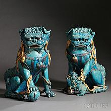 Pair of Large Buddhist Lions, China, 17th century, glazed ceramic, as traditionally depicted, the male holding a globe under his paw an