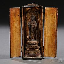 Portable Lacquer Buddhist Shrine, Japan, 18th/19th century, elliptical column-shape, enshrining a wood carving of Amitabha Buddha, with