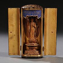 Portable Lacquer Buddhist Shrine, Japan, 19th/20th century, elliptical column-shape, enshrining a wood carving of Kannon Bosatsu, with