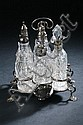 GEORGE III SILVER AND CUT-CRYSTAL CRUET SET. Samuel Wood, London, 1761. - 13 oz., 2 dwt.; 8 in. high, stand.
