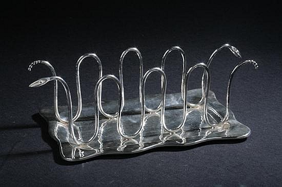EMILIA CASTILLO SILVER PLATED TOAST HOLDER. Stamped TO-85, Emilia Castillo Mexico, Plateado. - 3 1/2 in. high x 10 1/4 in. long.