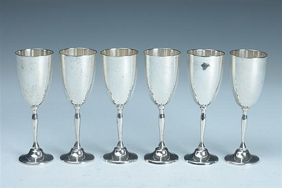 SIX MEXICAN STERLING SILVER CORDIALS, Circa 1950; P. Lopez G. mark. - 13 oz., 6 dwt.; 4 3/4 in. high.