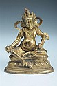 TIBETO-CHINESE GILT BRONZE OF DEITY. - 7 in. high.
