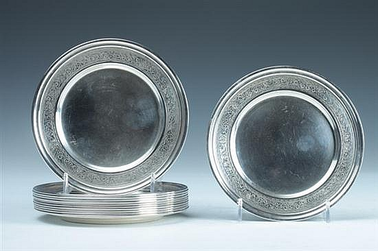 TWELVE INTERNATIONAL STERLING SILVER BREAD AND BUTTER PLATES. - 34 oz., 4 dwt.; 5 3/4 in. diam.