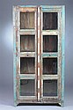HAND-CARVED AND POLYCHROME-PAINTED RUSTIC TWO-DOOR CUPBOARD. - 71 in. x 36 in. x 15 in.