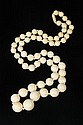 CARVED GRADUATED IVORY BEAD NECKLACE. - L: 38 in.