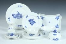 NINETY ONE PIECES ROYAL COPENHAGEN PORCELAIN IN THE BLUE FLOWER BRAIDED PATTERN, ALONG WITH A BLUE FLUTED PLAIN PATTERN WASTE BOWL.
