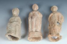 THREE GREEK HELLENISTIC TANAGRA TERRACOTTA FIGURES, Circa 4th Century B.C. - Largest: 7 3/8 in. high.