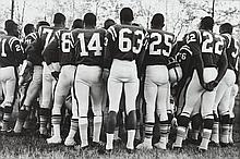 LEONARD FREED (American, 1929-2006). USA 1965 (aka African American Football Players Standing), signed and stamped verso. Silver gelati