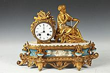 FRENCH GILT METAL MANTLECLOCK WITH SEATED FEMALE FIGURE. 19th Century. - 11 3/4