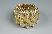 SIGNED MORELLI 18K YELLOW GOLD AND DIAMOND DESIGNER BAND, retailed by Saks Fifth Avenue. - Size: 5 1/2 W: 25.10 g, app. 3.00 d.w.t..