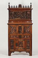 CONTINENTAL RENAISSANCE REVIVAL FIGURAL CARVED WALNUT AND OAK CABINET, 19th century,. - H: 95 in. x W: 45 1/2 in. x D: 18 in.