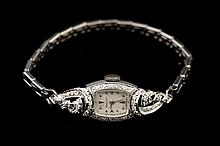 LADY'S 14K WHITE GOLD AND DIAMOND WRISTWATCH, By Mathey-Tissot, circa 1950.