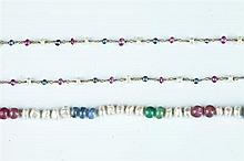 TWO FRESH WATER PEARL AND PRECIOUS COLORED GEMSTONE BEAD NECKLACES.