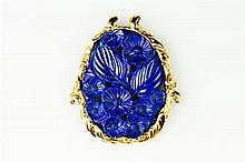 CHINESE YELLOW GOLD AND FLORAL-CARVED LAPIS LAZULI OVAL PENDANT,