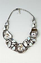 ARTISAN-CRAFTED STERLING SILVER, MOTHER-OF-PEARL, OPAL AND OTHER COLORED GEMSTONE BIB CHOKER.