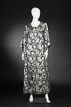 CUSTOM-MADE BLACK SATIN AND SILVER BROCADE KAFTAN, 1960s.