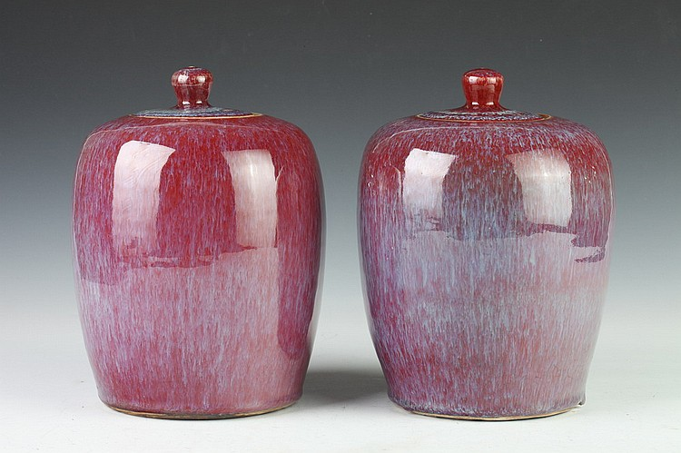 PAIR CHINESE FLAMBÉ PORCELAIN OVOID JARS AND COVERS, Qing Dynasty. - 9 1/2 in. high.