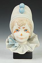 CYBIS HAND-PAINTED BISQUE PORCELAIN BUST OF YOUNG HARLEQUIN, - 9 in. high.