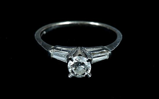 PLATINUM AND 14K WHITE GOLD AND DIAMOND ENGAGEMENT TYPE RING.