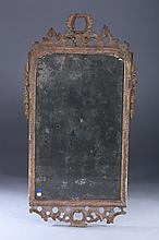 QUEEN ANNE CARVED AND SCRUBBED PINE HANGING LOOKING GLASS, early 18th century, with traces of original gilt and original plate intact.
