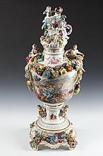 GERMAN POLYCHROME PORCELAIN PALACE-SIZE COVERED URN WITH SEPARATE BASE. 19th century, underglaze blue mark of Carl Thieme at Potschappe