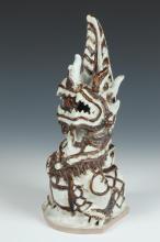 THAI SAWANKHALOK CHOCOLATE AND WHITE STONE WARE FIGURE OF THE MAKARA DRAGON, Circa 14th/16th Century. - 12 in. high.