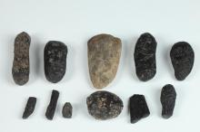 COLLECTION OF THAI PREHISTORIC BLACK INDOCHINITE TEKTITES. - Largest: 3 7/8 in. long.
