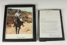 AUTOGRAPH-SIGNED PRESIDENT RONALD REAGAN COLOR PHOTOGRAPH OF REAGAN ON HORSEBACK. - Photograph, 8 in. x 10 in.