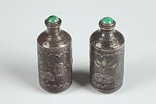 TWO CHINESE STERLING SILVER SNUFF BOTTLES, Li Chun mark. - 2 1/8 in. high.