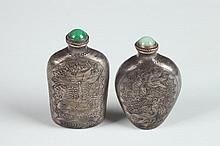 TWO CHINESE STERLING SILVER SNUFF BOTTLES. - 2 3/8 in. high.