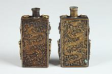 TWO CHINESE GILT BRONZE DRAGON SNUFF BOTTLES, One with Nei Fu Jian Zhi mark, the other with Guanxu er nian mark. - 3 3/4 in. high.