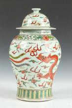 CHINESE FAMILLE VERTE DRAGON AND PHOENIX BALUSTER VASE AND COVER, 20th Century. - 15 1/2 in. high.