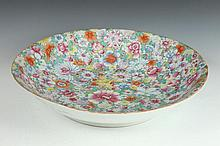 CHINESE FAMILLE ROSE MILLE FLEURS PORCELAIN SHALLOW BOWL. - 20 3/4 in. diam.