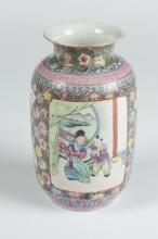 CHINESE FAMILLE ROSE PORCELAIN VASE, Qianlong four character iron red mark, early 20th century. - 6 7/8 in. high.