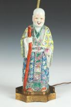 CHINESE FAMILLE ROSE PORCELAIN FIGURE OF AN IMMORTAL, - 12 1/8 in. high.