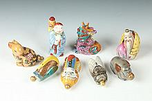 EIGHT CHINESE FAMILLE ROSE PORCELAIN SNUFF BOTTLES, Qianlong mark on five bottles. - Largest: 3 1/8 in. long.