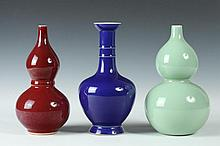 THREE CHINESE MONOCHROME PORCELAIN VASES, Two with Qianlong mark, 20th Century. - Largest: 8 1/2 in. high.
