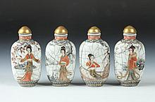 FOUR CHINESE FAMILLE ROSE PORCELAIN SNUFF BOTTLES, Qianlong mark, early 20th Century. - 3 in. high.